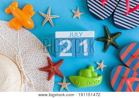 July 21st. Image of july 21 calendar with summer beach accessories and traveler outfit on background. Summer day, Vacation concept.