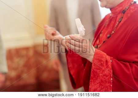 Old Woman Ceremony Master Perfoming Speech In Red Dress  At Wedding Ceremony Reception Holding Weddi