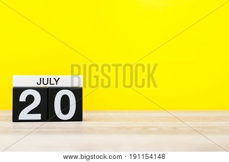 July 20th. Image of july 20, calendar on yellow background. Summer time. With empty space for text.