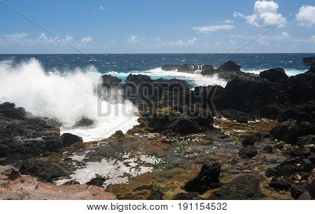 Rugged and beautiful Olivine pools on coastline around north east of Hawaiian island of Maui on Kahekili highway poster