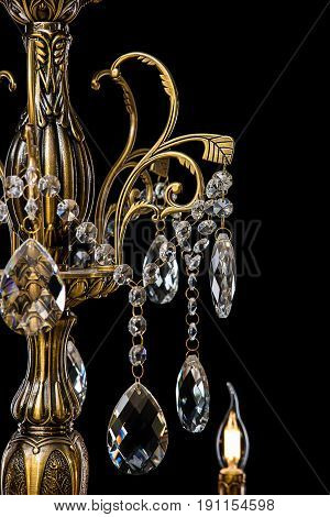 Large crystal chandelier close-up in baroque style isolated on black background. Luxury royal expensive chandelier for living room, Hall of celebration.