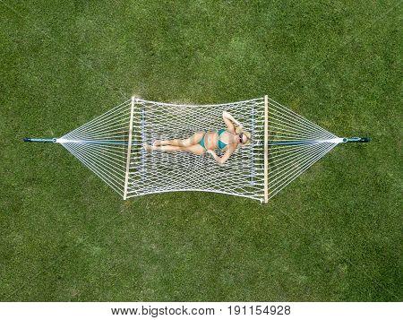 Blonde model relaxing on a hammock