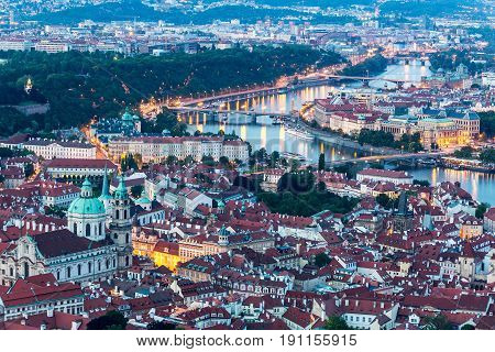 Prague at twilight blue hour, view of Prague Castle and Saint Vitus cathedral in Czech Republic.