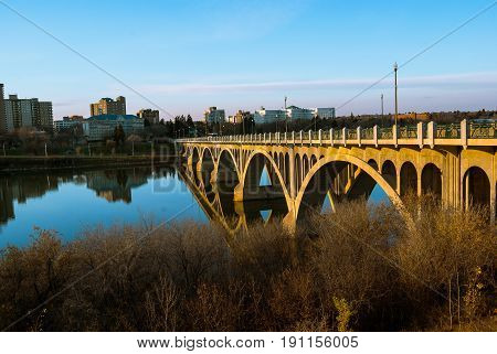 A bridge in Saskatoon turns golden from the setting sun's light
