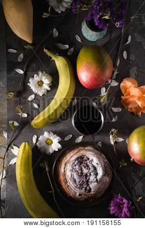 Tea party still ife with fruits and flowers vertical