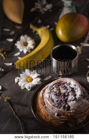 Tea party still ife with fruits and flowers on the stone vertical