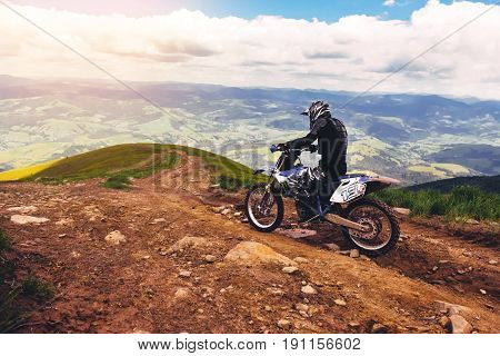 Carpathian mountains in Ukraine.Man rides a motorcycle in the mountains. Mountain range in summer Green mountain peak mountain landscape.