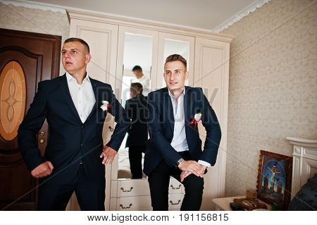 Groomsman And Best Man Or Groomsmen Standing In A Groom's Room.