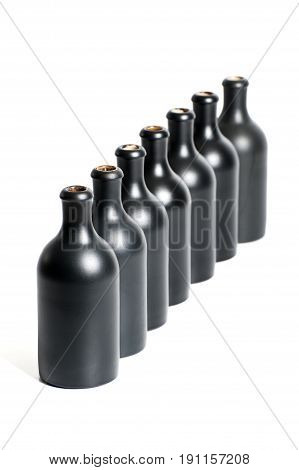 A Set Of Several Empty Black Bottles On A White Background Close-up..