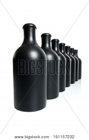 Seven Matte Black Bottles On A White Background..