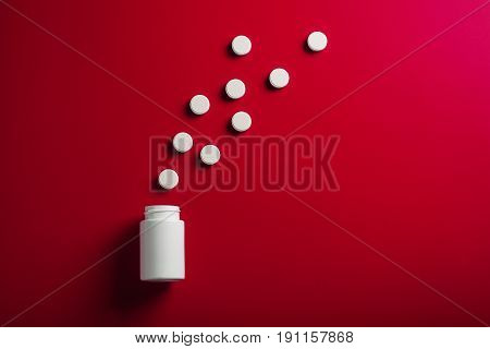 Medical Pills Round Shape And Bright Bottle Red Background