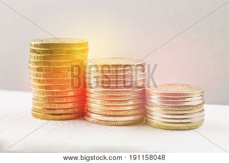 Stacks Of Russian Coins On A Gray Background With Droplets Of Water.