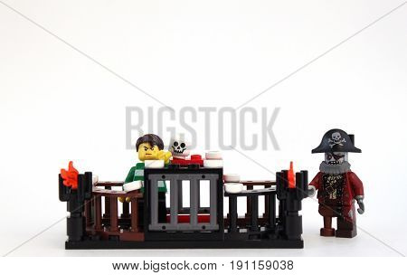 Colorado, USA - June 14, 2017: Studio shot of Lego minifigure pirate with a sailor in jail.