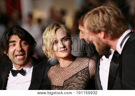Faith Akin, Diane Kruger, Numan Acar  attend the 'In The Fade (Aus Dem Nichts)' premiere during the 70th Cannes Film Festival at Palais des Festivals on May 26, 2017 in Cannes, France.