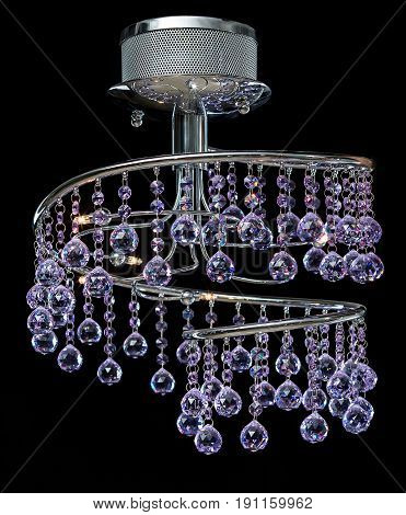 Modern high-tech chandelier of purple color crystals isolated on black. Chandelier for interior of the living room