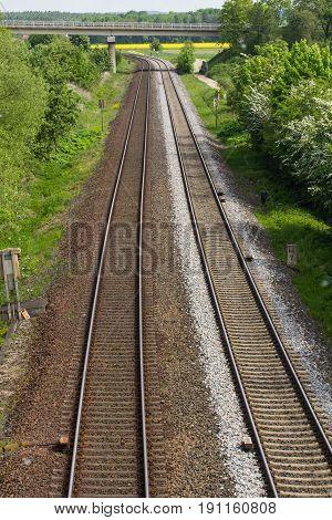 a rail track picture taken from a bridge next to Schwandorf in Bavaria