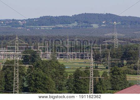electrical towers within a beautifull bavarian landscape