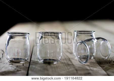 Empty Jars On A Wooden Table, Black Background