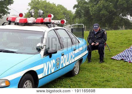 Beaulieu, Hampshire, Uk - May 29 2017: Classic Nypd Police Patrol Car And Enthusiast Driver In Unifo