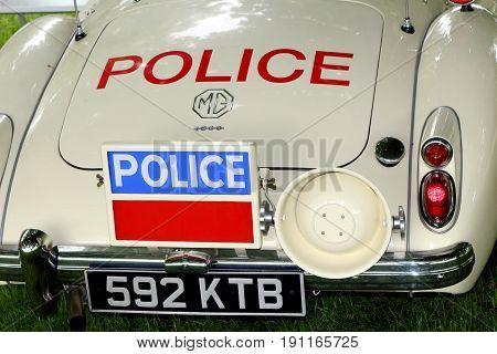 Beaulieu, Hampshire, Uk - May 29 2017: Nice Rear Shot Of A Classic Vintage Mga Roadster In Uk Police