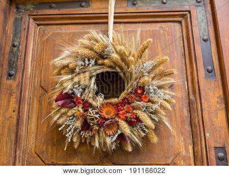 Advent Christmas wreath on wooden door decoration.