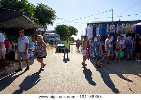 El Raso, Alicante, Spain - July 2, 2016: Different people Buyers and sellers in the rural market, Mercadillo de Campo de Guardamar