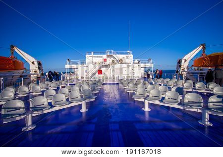SOUTH ISLAND, NEW ZEALAND- MAY 25, 2017: Communal area where people sits during ferry trips that provide daily connection between North and South islands with a beautiful blue sky located in New Zealand.