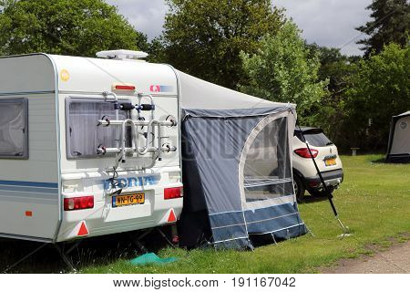 St Leonards, Hampshire, Uk - May 30 2017: Caravan, Awning And Car With Dutch Or Netherlands Registra