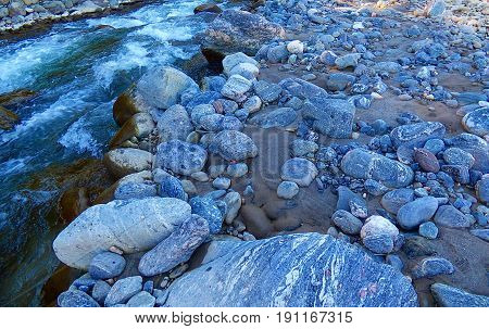 Rocks next to the river. Geologic and mineral. Nature