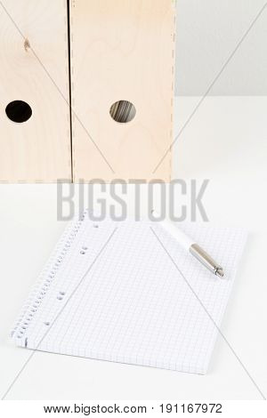 White office desk with empty notepad pen and folders - study or workplace background mock up