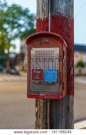 Emergency Reporting System box to notify the police and fire department on old wooden pole Brooklyn New York