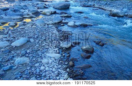 Rocks next to the river. Geologic and mineral. Nature. Riverscape
