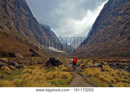 Adventure of single traveler man in Nepal, Annapurna region, Annapurna Base Camp track. Mountain Landscape in Himalaya.