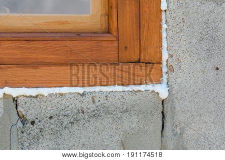 Construction Foam. Foam Of A Stroiteln At A Window.