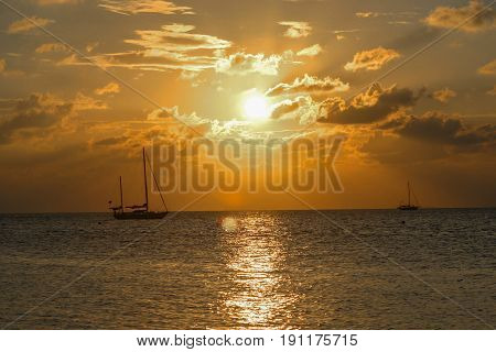 Sailboat against sunset in Key West FL