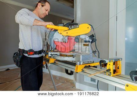worker cuts board on circular saws man cutting wood on electric saw