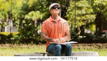 Handicapped People With Disability Blind Man Reading Braille Book