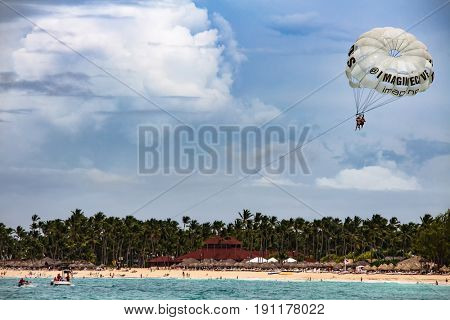 Punta Cana, Dominican Republic - July 03, 2016: Tourists para-sailing in Punta Cana beach resort. Para-sailing is a popular recreational activity among tourists in Punta Cana resorts.