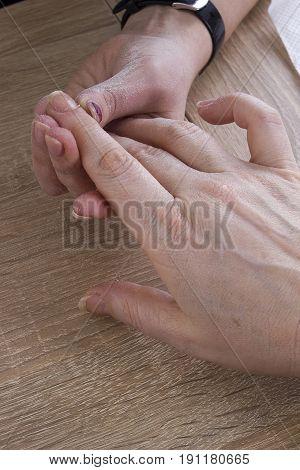 Professional manicure procedure in beauty salon. Hands close up.