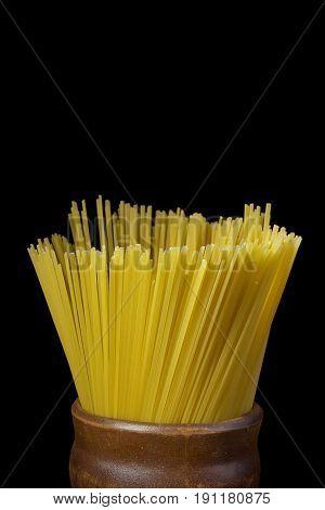 Beam Italian spaghetti in a clay cup