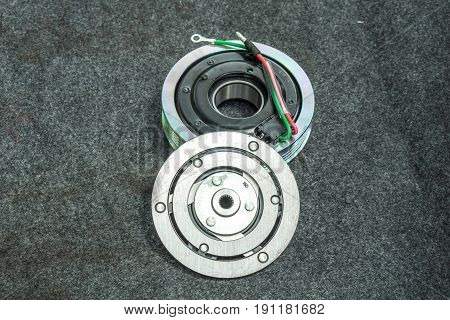 Car part and air conditioner system concept - Closeup new clutch pad and pulley of car air compressor system for replace new part service and copyspace