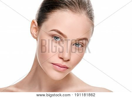 Portrait of beautiful calm young woman with natural makeup