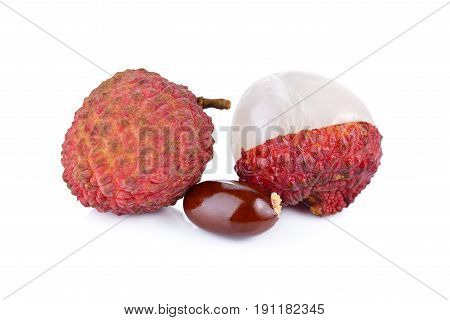 whole and peeled ripe Lychee with seed on white background