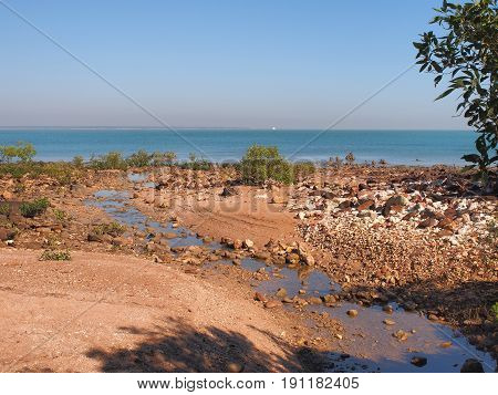 Foreshore with sand rocks mangroves and ocean at east point reserve Darwin 2017