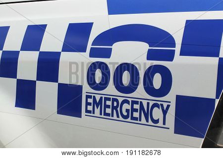 Melbourne Australia - April 24 2017: Tripple zero numbers and blue and white sign on a police car