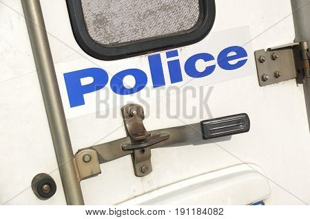 Melbourne Australia - April 24 2017: Back door of a police car with locks and sign of the Victorian Police