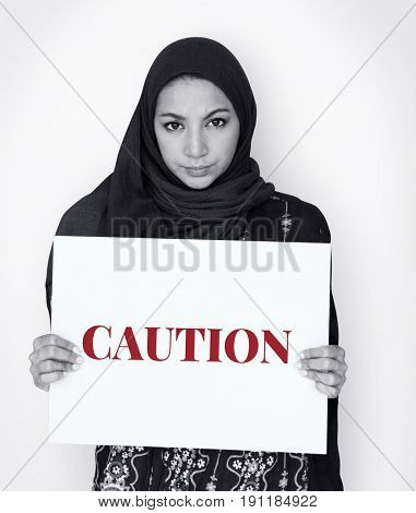 Woman hold caution alert sign