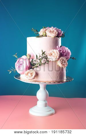 Pink Cream Wedding Cake Decorated With Fresh Roses