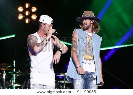 NASHVILLE, TN-JUN 10: Country singers Tyler Hubbard (L) and Brian Kelley of Florida Georgia Line perform in concert at CMA Music Festival on June 10, 2017 at Nissan Stadium in Nashville, Tennessee.