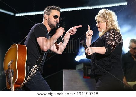 NASHVILLE, TN-JUN 9: Country singers Eric Church (L) and Joanna Cotton perform in concert during the 2017 CMA Music Festival on June 9, 2017 at Nissan Stadium in Nashville, Tennessee.